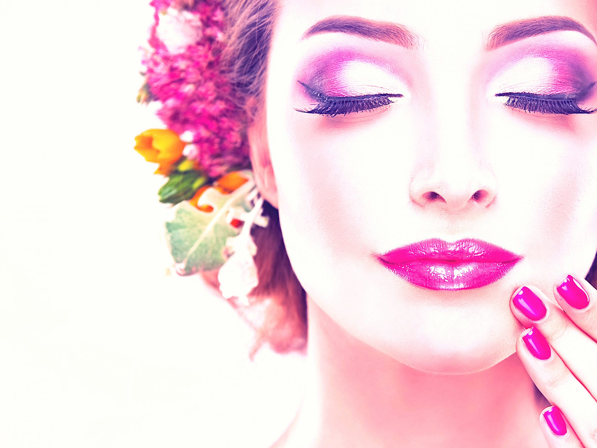 Girl with delicate  flowers in hair and fashion  fuchsia nail